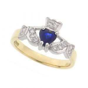kinvara-claddagh-ring-in-18-karat-yellow-gold-and-sapphire